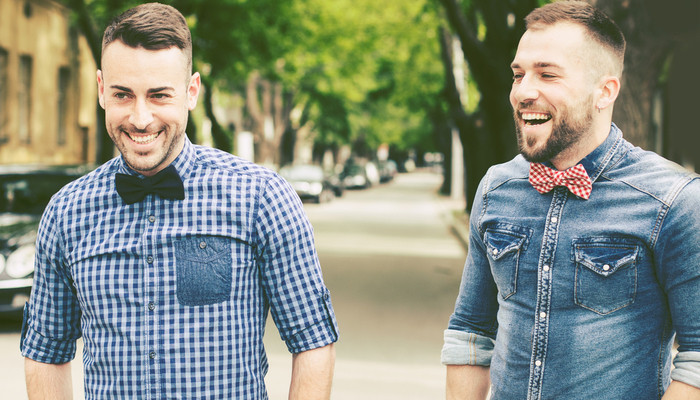 Hipster friends laughing at the street