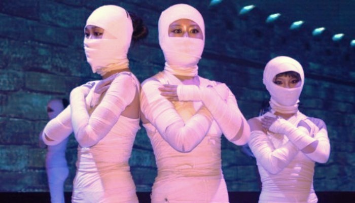 women dressed as mummies
