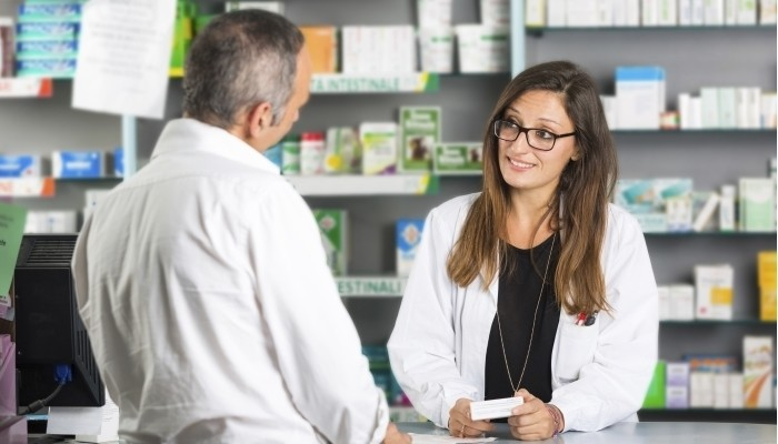 Pharmacist with client