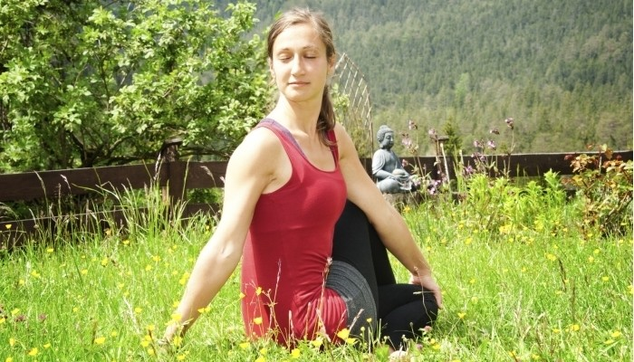 Seated Twist Yoga in the Garden