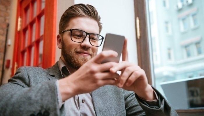 man using job search app on smartphone