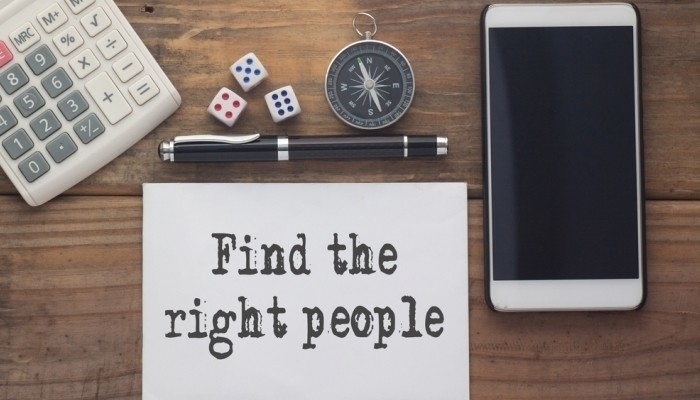 find the right people on wooden table