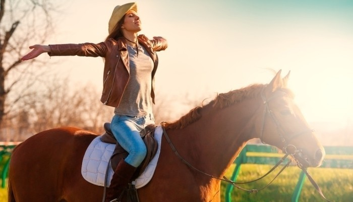 beautiful woman riding a horse