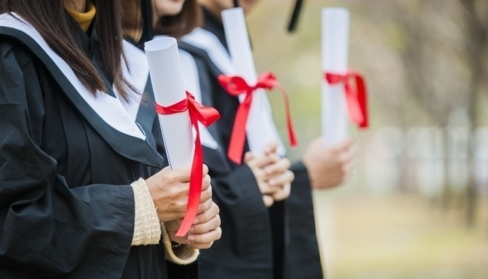 students holding master degrees
