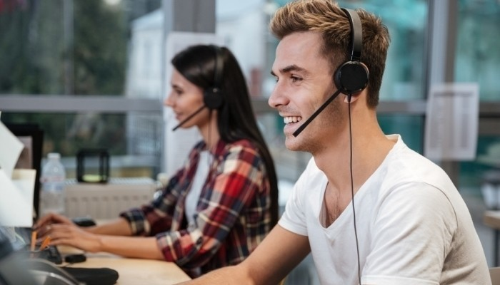 smiling workers in call center