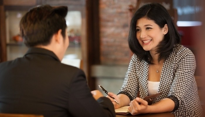 attractive woman job interview in coffee shop
