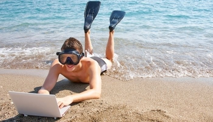 man working on beach in goggles and flippers