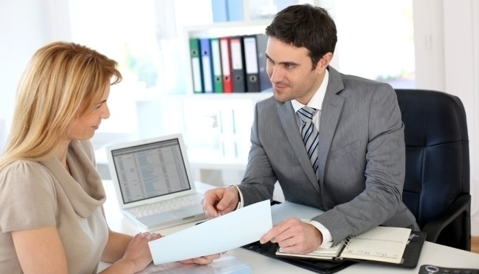 Financial adviser with client