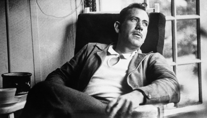 John Steinbeck sitting on a chair
