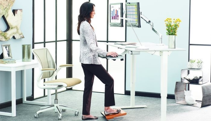 Woman working at standing desk