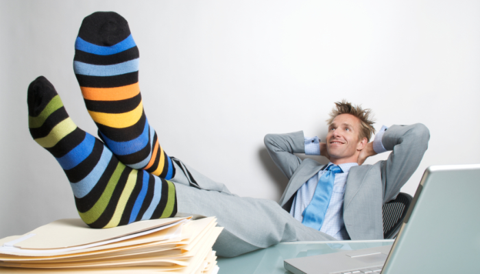 Businessman with feet on desk