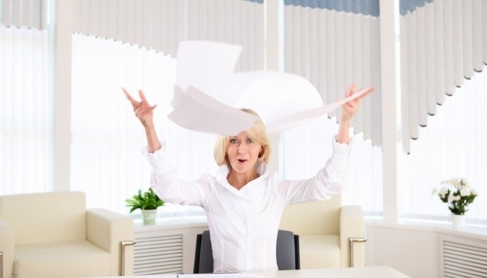 woman throws paper