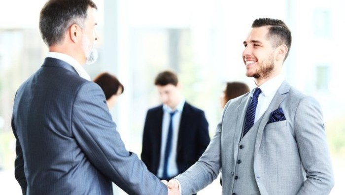 business people give handshake