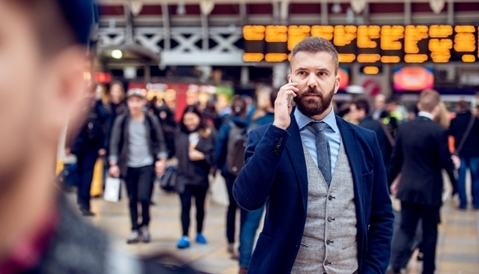 Busy businessman with smartphone, making phone call