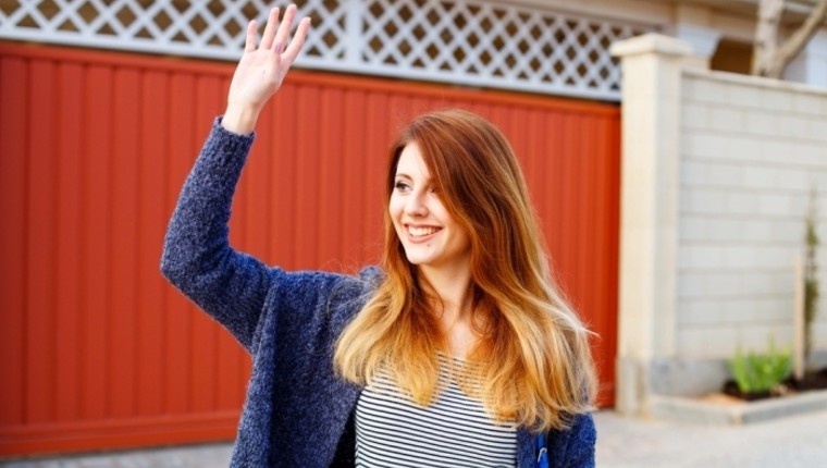girl waving