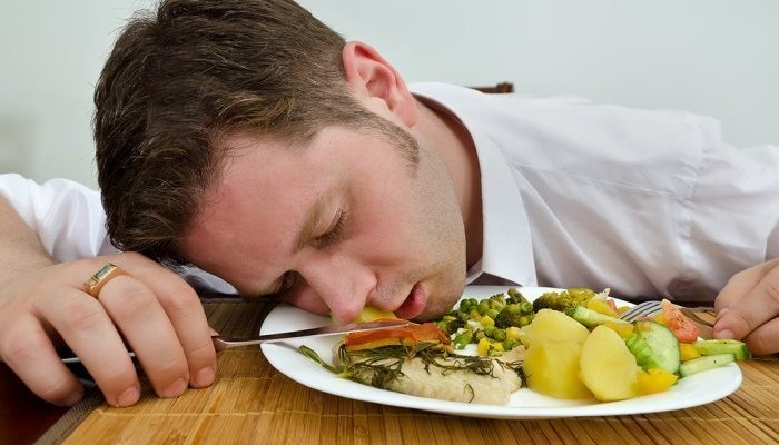 Man falling asleep while eating
