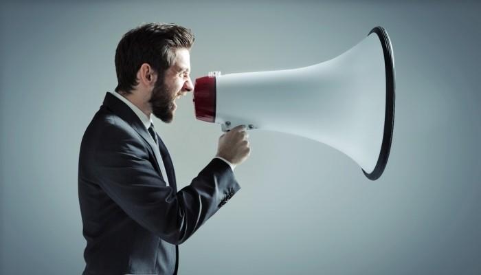 Businessman with large megaphone