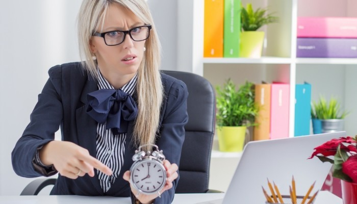 woman is angry about being late at work